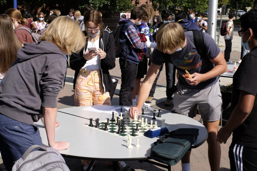Students at club rush gather around the chess clubs table.