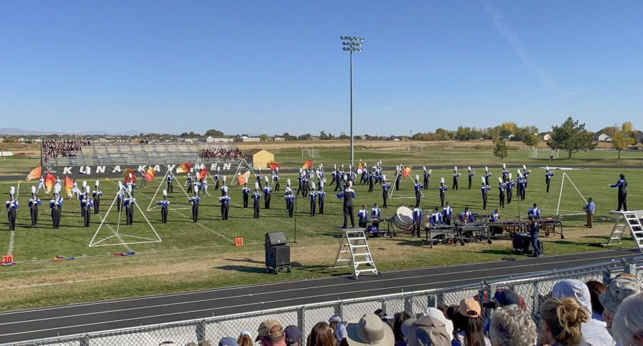 Full shot of the band playing their piece.