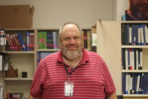 Mr. Haines, the in-house suspension coordinator smiles in the bookroom.